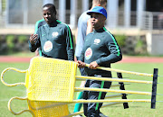 SA Under-20 national men's team head coach Thabo Senong (R) with his assistant coach Helman Mkhalele (L) during a training session at University of Johannesburg Soweto Campus on May 9, 2018.