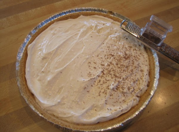 Spoon into prepared pie crust.  Top with grated chocolate (if desired) and cover....