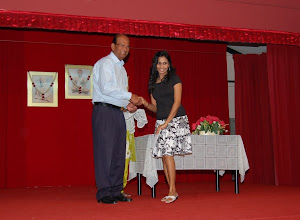 Photo: Mrs Rajeswari receiving Scholarship Award