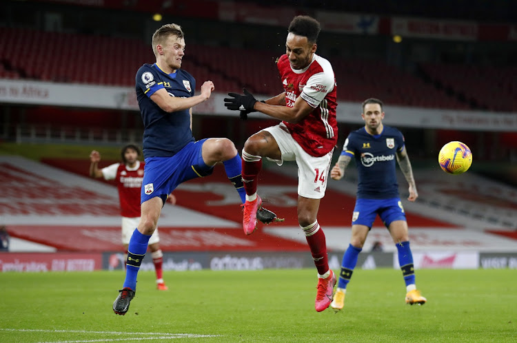 James Ward-Prowse of Southampton battles for possession with Pierre-Emerick Aubameyang of Arsenal.