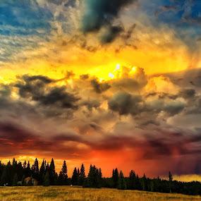 Sunset over Brazos Peak by Jeffrey Genova - Landscapes Sunsets & Sunrises ( clouds, mountains, sunset, golden, sun, rain, new mexico,  )