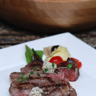 Grilled Ribeye Steak With Black Truffle Butter Buttons.