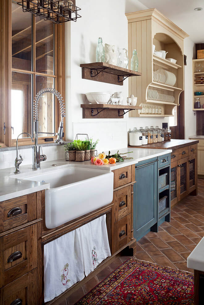 Rustic farmhouse kitchen with open shelving and natural wood cabinetry.