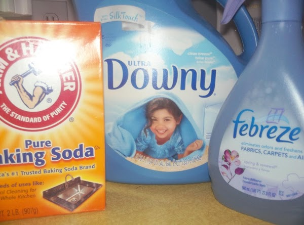 Using a funnel, pour Downy* in a 27 oz spray bottle. I use an...