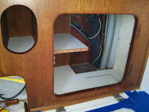 Photo: cut away of galley cabinets to provide access to deck fittings complete.  Guess I've created some cosmetic work.