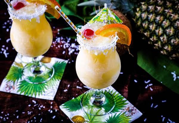 Pina Colada Slush Garnished With Fresh Fruit.
