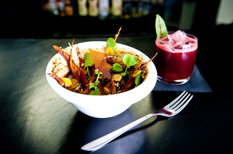 Photo: Roasted carrots and a cocktail called the Sandworm featuring beet juice at Empellon Cocina