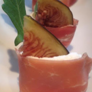 Fresh Figs With Goats Cheese, Arugula Wrapped In Prosciutto.