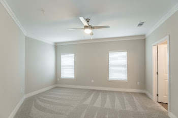 B3 bedroom with carpet and ceiling fan