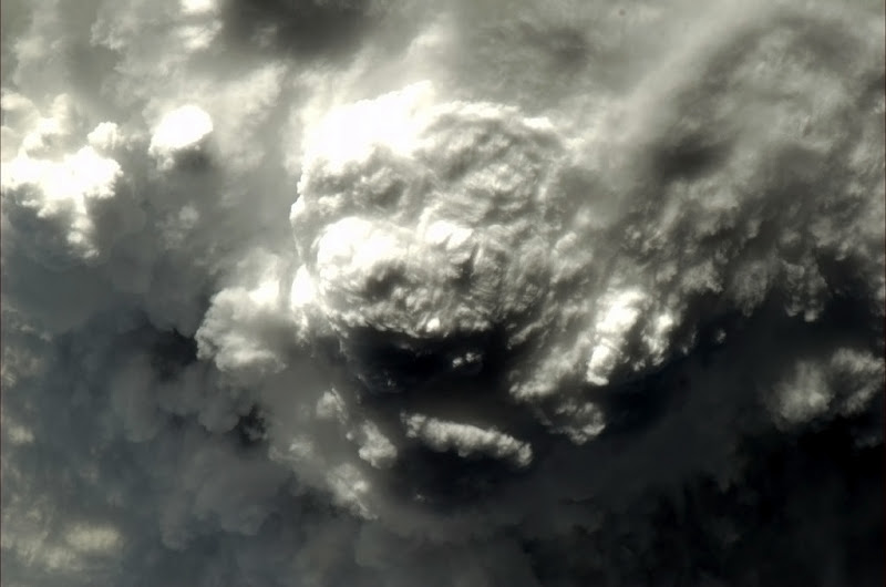 Photo: Thunderstorm from above. What animal to you see?