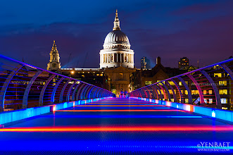 "Photo: Psychedelic Colors at the Millennium Bridge, with St. Paul's - London, U.K.  The River Thames is a colorful sight with several bridges displaying colors they don't normally show on a non-Olympic night. At the Millennium Bridge, lights change every few seconds and create a nice psychedelic glow. ... The London Millennium Bridge is a pedestrian-only steel suspension bridge crossing the Thames and linking Bankside with the City. It is also referred as the ""Wobbly Bridge"" after an uncomfortable, swaying motion was noticeably felt on the first two days of the bridge's opening on June 2000. Attempts to modify the bridge to eliminate the vibrations were made and the bridge reopened in 2002. Other than being another architectural marvel on the Thames, the Millennium bridge is also known as the fictional Brockdale Bridge in the 2009 film Harry Potter and the Half-Blood Prince. The alignment of the bridge is also such that a clear view of St Paul's Cathedral is seen from across the river, framed by the bridge supports.  #MillenniumBridge   #StPaul   #London2012   #Olympics   #UK   #Travel   #Photography   © Yen Baet - www.YenBaet.com. All Rights Reserved. Join me on Facebook at www.facebook.com/YenBaetPhotography."