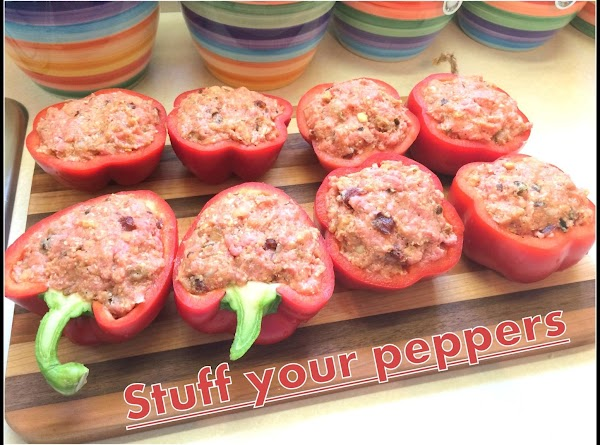 Stuff your peppers with the meatloaf  and place them in a baking pan.