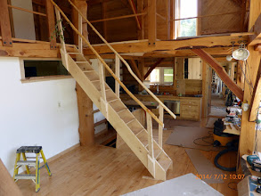 """Photo: Stairway simply sets into the french clip w/o any attachments; posts slip in & out of pockets; rails & their pegs slip into the posts; very light-weight pine we'd milled on site for main house flooring.  Note trap door in background.  3 kids stayed upstairs for a week & used stair as jungle gym & played """"king of the mtn."""" - no problems."""