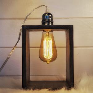 lampe à poser en béton de couleur gris acier avec détail industriel