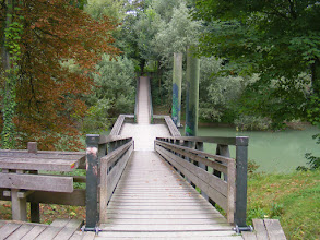 Photo: Now on the wooden bridge leading across the Marne river.