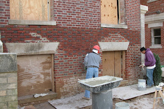 Photo: October 2004 - Month 14: Francisco and Leo repointing ALL the brick on the front of the house. Beautiful new large windows in Room 101