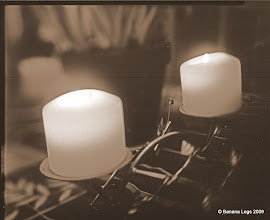 Photo: Two candles.  4x5 view camera.  f/5.6, 1min,30sec, paper negative and yellow filter, sepia tinted. Swing and down-shift of lens.