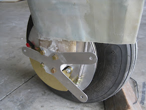 Photo: Wheel pant mount and PTFE/SS brake lines visible.  Nut-plates still to be added to wheel pant mount.