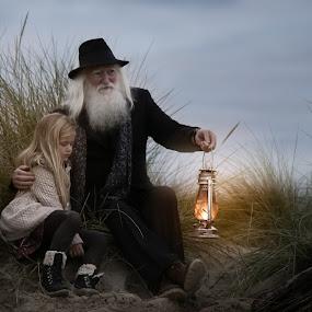 Granpa by Una Williams Photos - People Family ( story, girl, grandfather, lamp, beach )