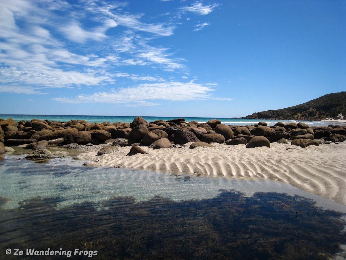 Mini sandy dunes on Stokes Bay rocky lagoon