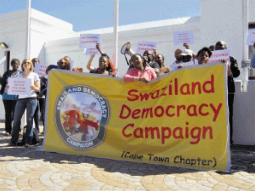 UPROAR:  About 100 Swaziland democracy activists protested outside Parliament yesterday against the R2,4billion 'bailout' loan granted by the South African government to the Swazi government last month. PHOTO: ANNA MAJAVU