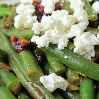 Green Beans with Cranberries, Almonds, and Goat Cheese in a Fig Balsamic Glaze.