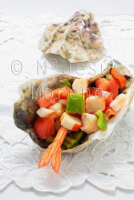 Photo: seafood salad on white background,served in a seashell