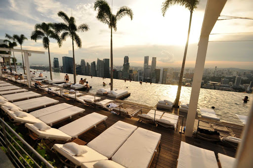 infinity-pool-marina-bay-Singapore.jpg - The Marina Bay Sands rooftop infinity pool at the Merlion hotel offers a stunning view of the surrounding bay in Singapore.