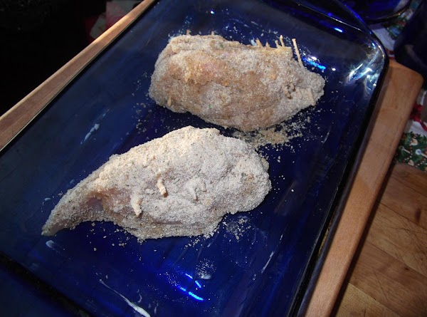 Carefully roll stuffed chicken breasts first in melted butter, then in crumb mixture to...
