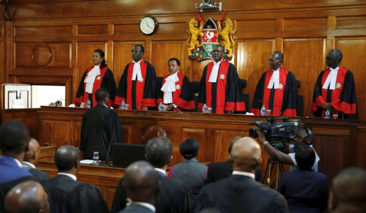 Kenya's Supreme Court judges enter the court room before delivering the ruling making last month's presidential election in which Uhuru Kenyatta's win was declared invalid in Nairobi, Kenya September 1, 2017. Picture taken September 1, 2017.