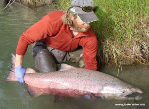 Photo: Jeremy Anderson with a King salmon from the Kasilof River.