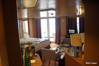 Photo: Neptune Suite SC6177 on the Westerdam has an aft facing wrap around verandah.  In the left foreground you can see the complementary sparkling wine and sparkling water.