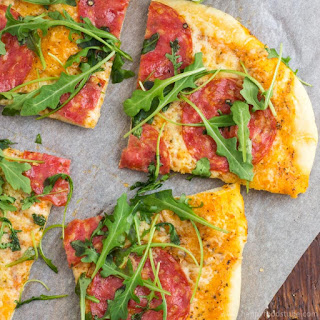 Salami Pizza with Cheese and Arugula.