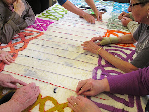 Photo: arranging the stencils so we can start needlefelting the letters