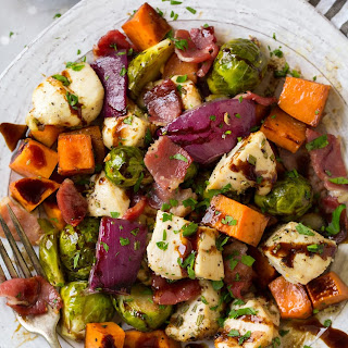 Sheet Pan Chicken Sweet Potatoes and Brussels Sprouts with Bacon and Balsamic Glaze.