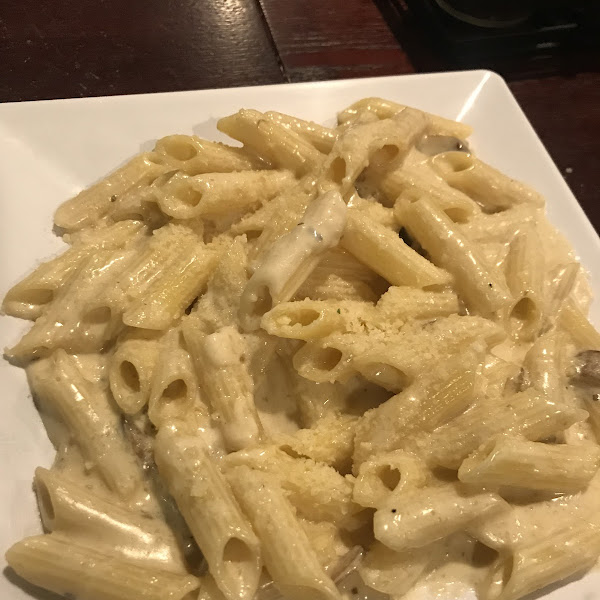 Pasta with alfredo, comes as the side to the Chicken Marsala