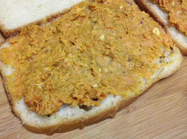 Combine all ingredients well. Divide in half and make 2 sandwiches. Best on homemade...