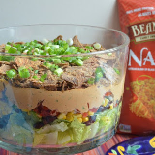 Layered Taco Salad Featuring Beanfields Nacho Chips.