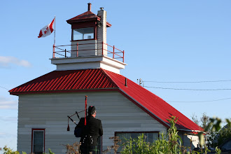 Photo: piper at the McKay Island Lighthouse