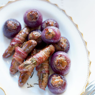 Sausages Wrapped In Bacon With Rosemary.