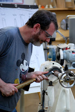 Photo: Here Steve works on shaping the butt of the handle.