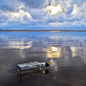 Bottle on the beach by Aparajita Saha - Artistic Objects Other Objects ( clouds, water, reflection, horizon, beach, bottle )