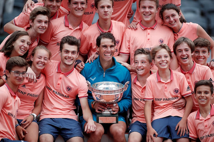 Spain's Rafael Nadal celebrates with ball boys, ball girls and the trophy after winning the final against Austria's Dominic Thiem at the French Open in Paris, France, June 10 2018. Picture: REUTERS