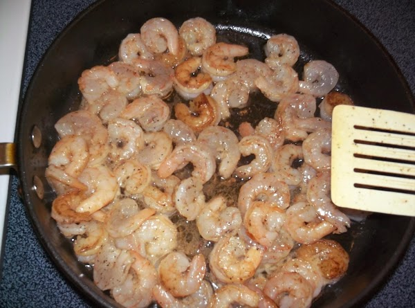 Place the raw shrimp (that's been peeled and deveined) right into the sausage grease....