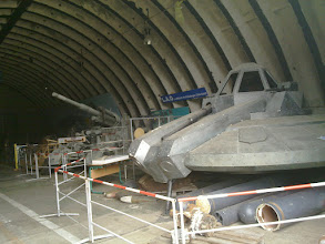 Photo: museum of ww2 aircraft wreckage. the item right seems to be not from ww2 but an art installation (hovercraft?).