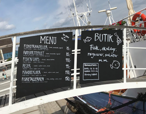 danish-fish-restaurant-menu.jpg - A menu in Danish at a fish restaurant on a boat along the waterfront.