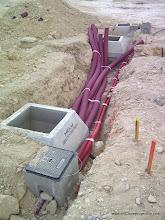 Photo: Tendido de redes eléctricas y de telecomunicaciones.