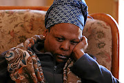 Tshepang Mogomotsi  mourns  after her husband Thami Tebele  was allegedly abducted and fatally beaten by his taxi boss./ Mduduzi Ndzingi