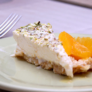 Yogurt and Pistachio Cheesecake with Oranges in Cardamom Syrup.