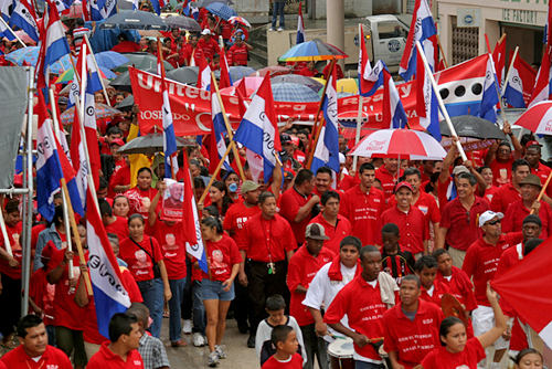 United Democratic Party supporters parade the streets of Orange Walk Town on nomination day 2008.